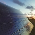 Solar panels field at sunset