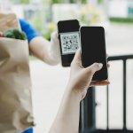 Customer,Hand,Using,Digital,Mobile,Phone,Scan,Qr,Code,Paying